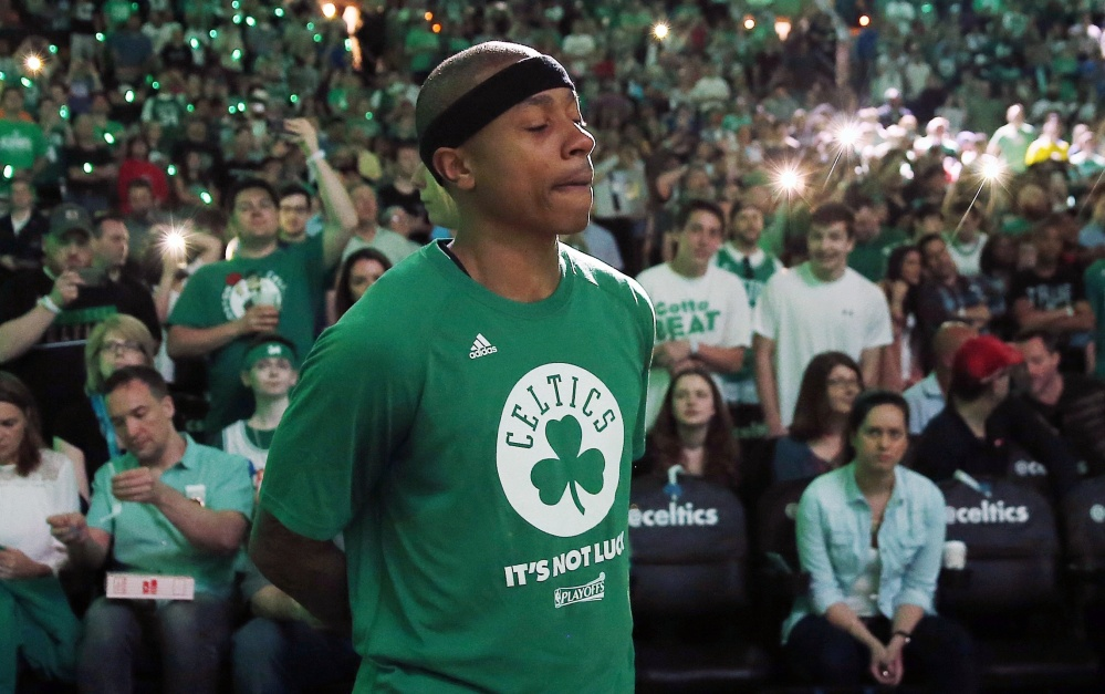 An emotional Isaiah Thomas stands by himself during pregame introductions April 16 in Boston. Thomas, playing the day after his sister died in a car accident, scored 33 points.