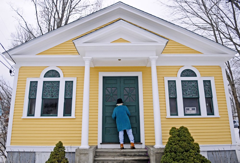 Shelia Sanford unlocks the front doors at the North Monmouth Library on Jan. 12. The Maine Historic Preservation Commission has placed the library on the National Register of Historic Places.