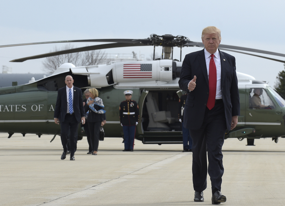 President Trump gives a thumbs-up as he lands at General Mitchell International Airport in Milwaukee on Tuesday. He visited tool manufacturer Snap-on Inc., in nearby Kenosha.