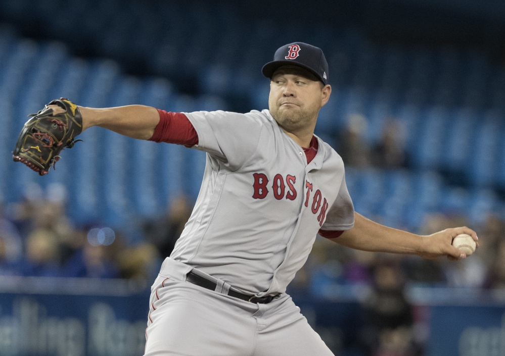 Boston Red Sox's starting pitcher Brian Johnson throws against the Toronto Blue Jays during the first inning on Tuesday.