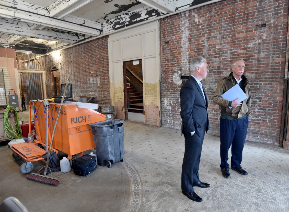 David Greene, president of Colby College, left, gives a tour Wednesday of the Hains Building on Main Street in downtown Waterville to U.S, Sen. Angus King.