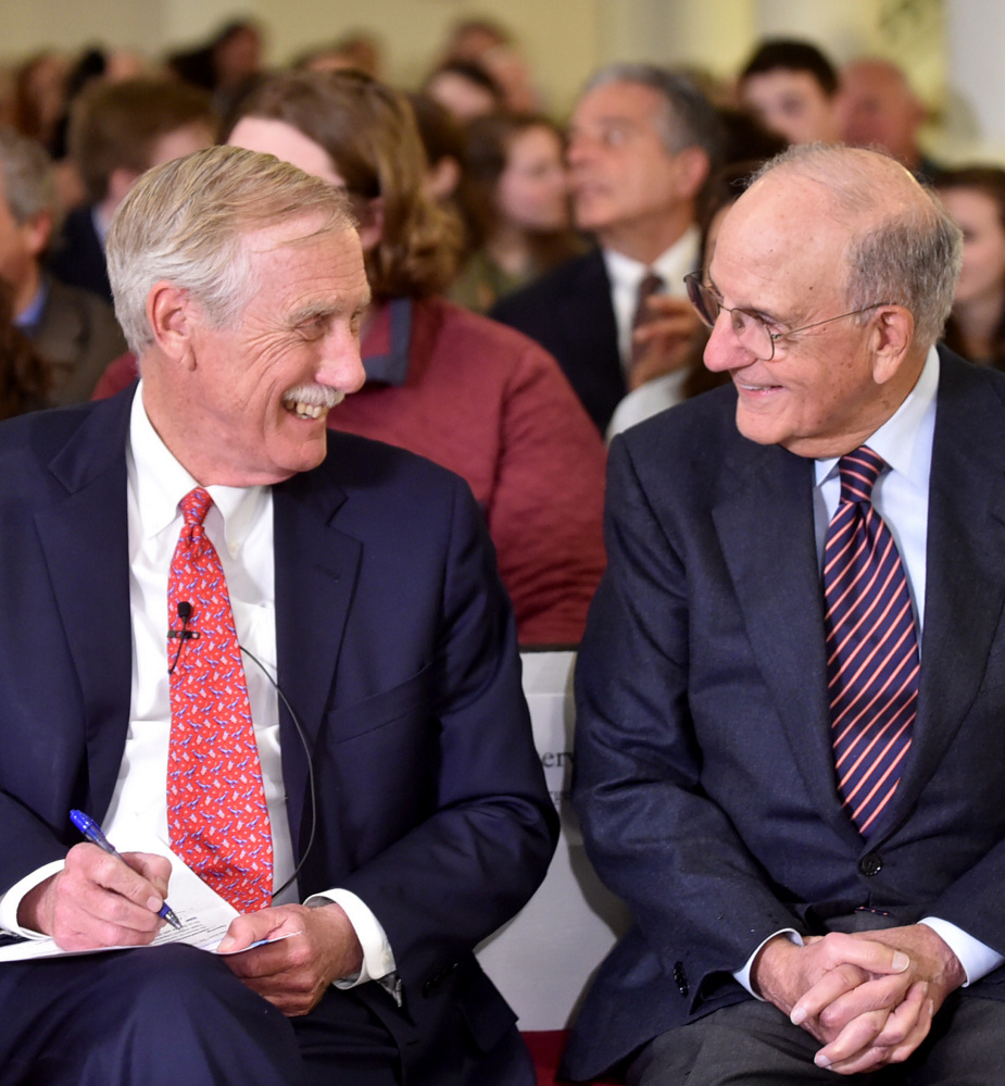 Sen. Angus King, left, and former Sen. George Mitchell chat before King's speech on international relations at the George J. Mitchell Distinguished International Lecture at Colby College Wednesday night.