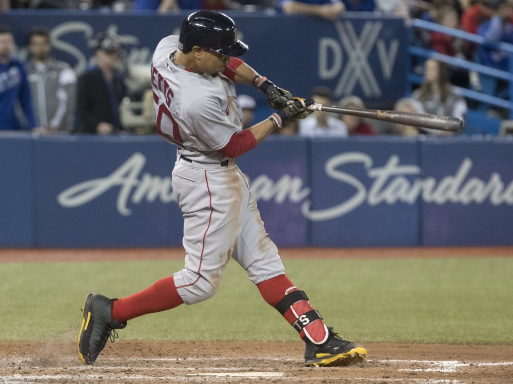 Mookie Betts hits a three-run double in the 10th inning Thursday to give the Red Sox a 4-1 win in 10 innings over the Blue Jays at Toronto.