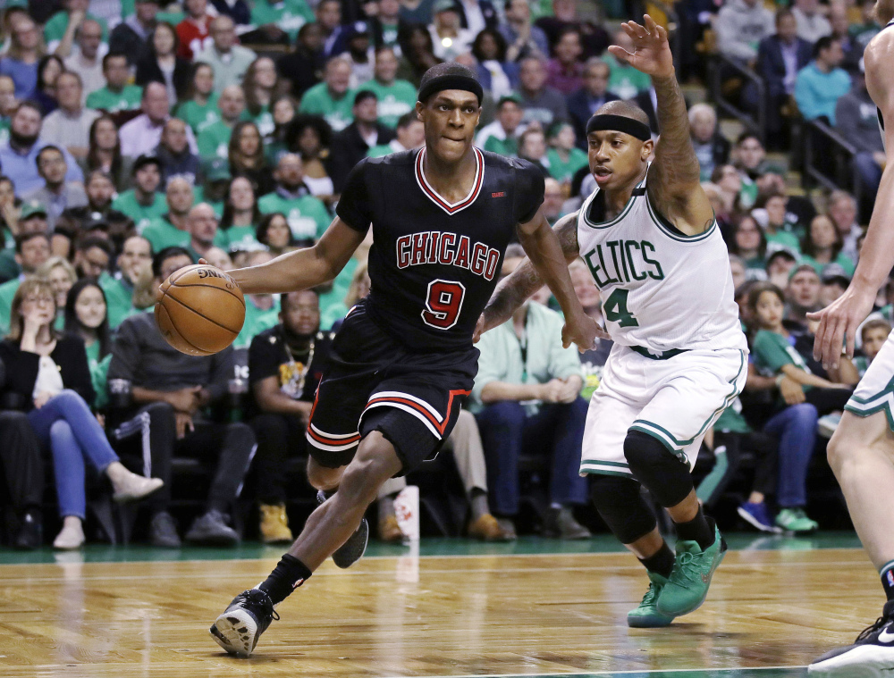 Chicago Bulls guard Rajon Rondo drives towards the basket past Boston Celtics guard Isaiah Thomas during Tuesday's playoff game in Boston.