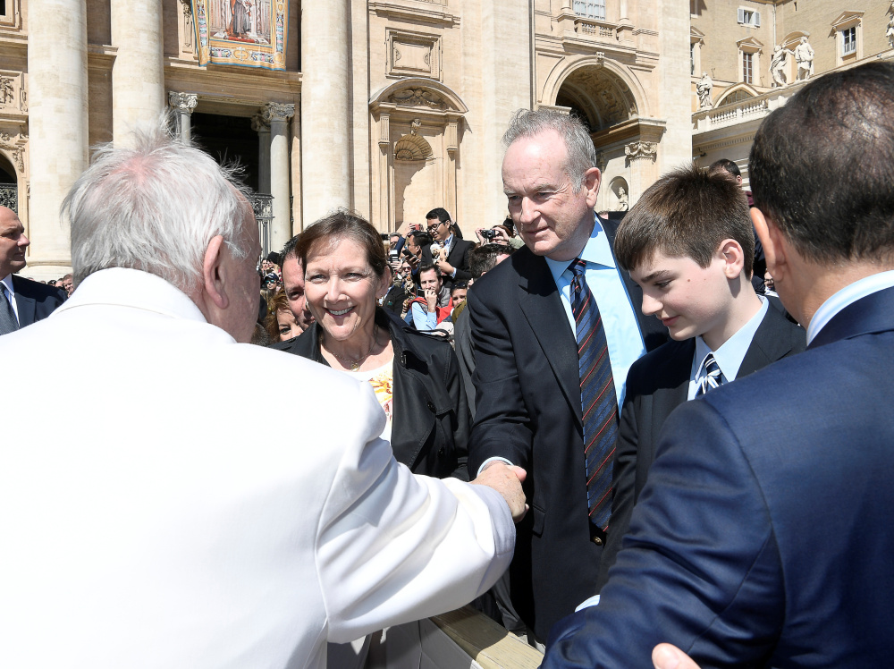Fox News Channel host Bill O'Reilly shakes hands with Pope Francis during the Wednesday general audience in St. Peter's Square at the Vatican.