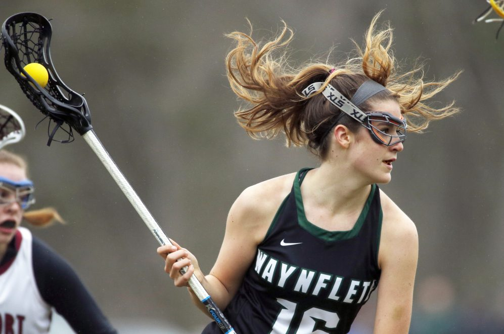 Waynflete attacker LZ Olney looks for space between Freeport defenders in Tuesday's game at Freeport. Olney had three goals and an assist as the Flyers improved to 2-0 with an 11-7 win.