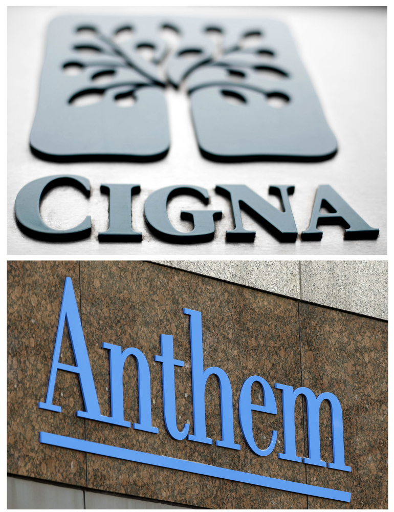 This combo of file photos shows signage for health insurers Cigna Corp., and Anthem Inc.  A federal appeals court on Friday left in place a decision blocking Blue Cross-Blue Shield insurer Anthem's bid to buy rival Cigna, saying that a bigger company is not better for consumers. The 2-1 decision upholds a federal judge's ruling in February that said the proposed $48 billion acquisition would reduce competition in the concentrated insurance market.