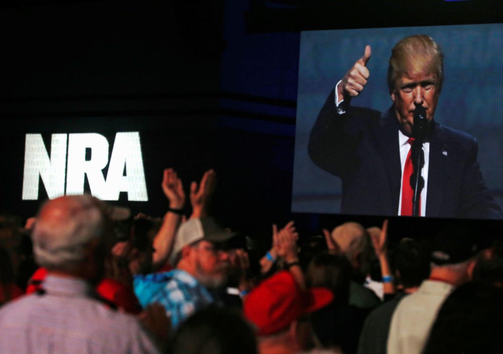 President Trump addresses the NRA's annual convention Friday in Atlanta.