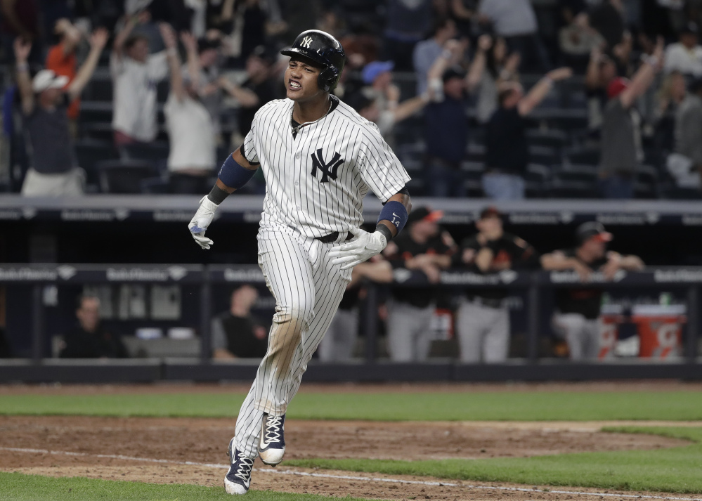 Starlin Castro of the Yankees celebrates after hitting a two-run homer in the ninth inning Friday to force extra innings against the Baltimore Orioles. The Yankees won in 10 innings, 14-11.