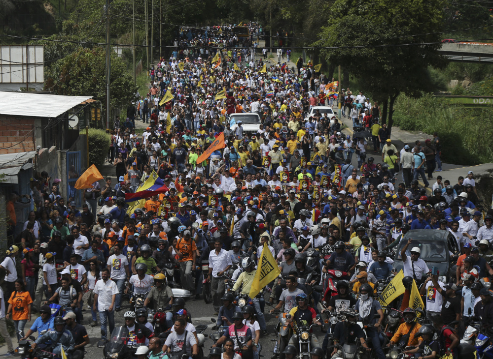 Opponents of President Nicolas Maduro march to the Ramo Verde military prison in Los Teques, on the outskirts of Caracas, Venezuela, on Friday. Venezuela's opposition called for a march to the prison where opposition leader Leopoldo Lopez is serving a nearly 14-year sentence for his role leading anti-government demonstrations in 2014.
