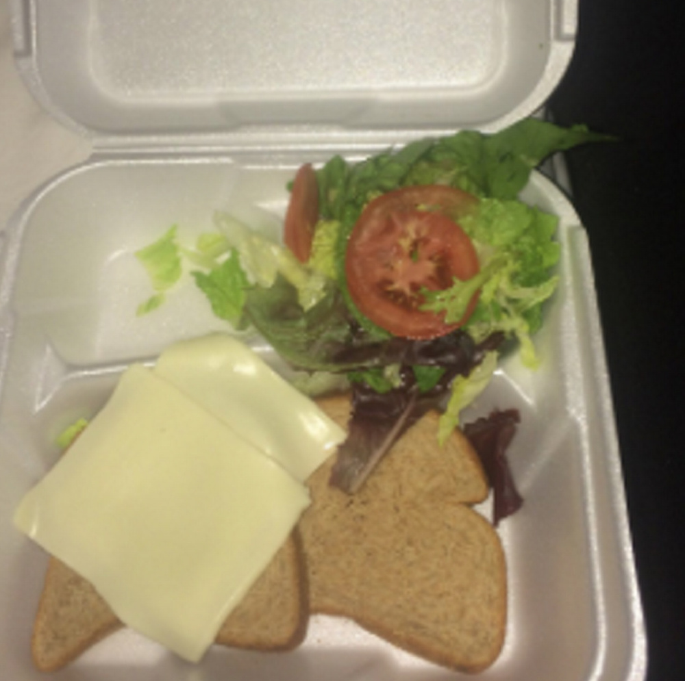 A meal provided to a Fyre Festival concert-goer consisting of bread, cheese and lettuce.