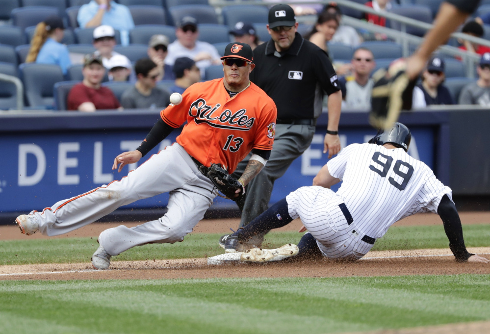 Aaron Judge of the New York Yankees steals third base Saturday as Manny Machado of the Baltimore Orioles fields the throw during the fourth inning of the Yankees' 12-4 victory.