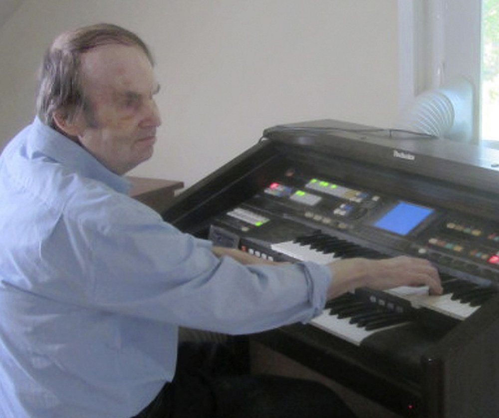 William Dean, who mastered the organ without any lessons, died in October at age 71, but the legal fight over his treatment by the state continues.