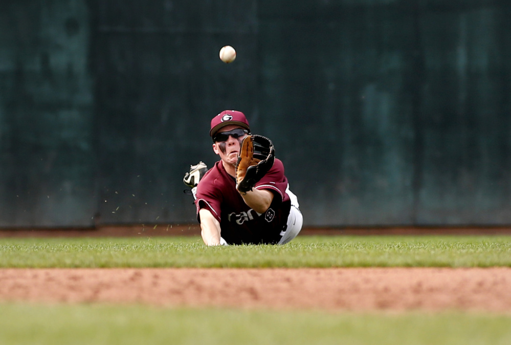 Lucas Roop of Gorham dives but can't make the catch in left field during his team's 10-1 win Saturday against Deering at Hadlock Field.