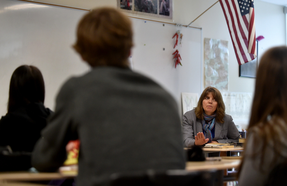 Teacher Deb Muise, facing, talks to her students Friday during English class at Mt. Blue High School in Farmington.