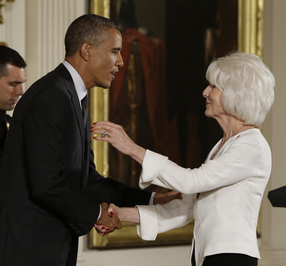 President Barack Obama awards the 2013 National Humanities Medal to longtime NPR radio host Diane Rehm in the East Room at the White House in July. Rehm recently got engaged at age 80.