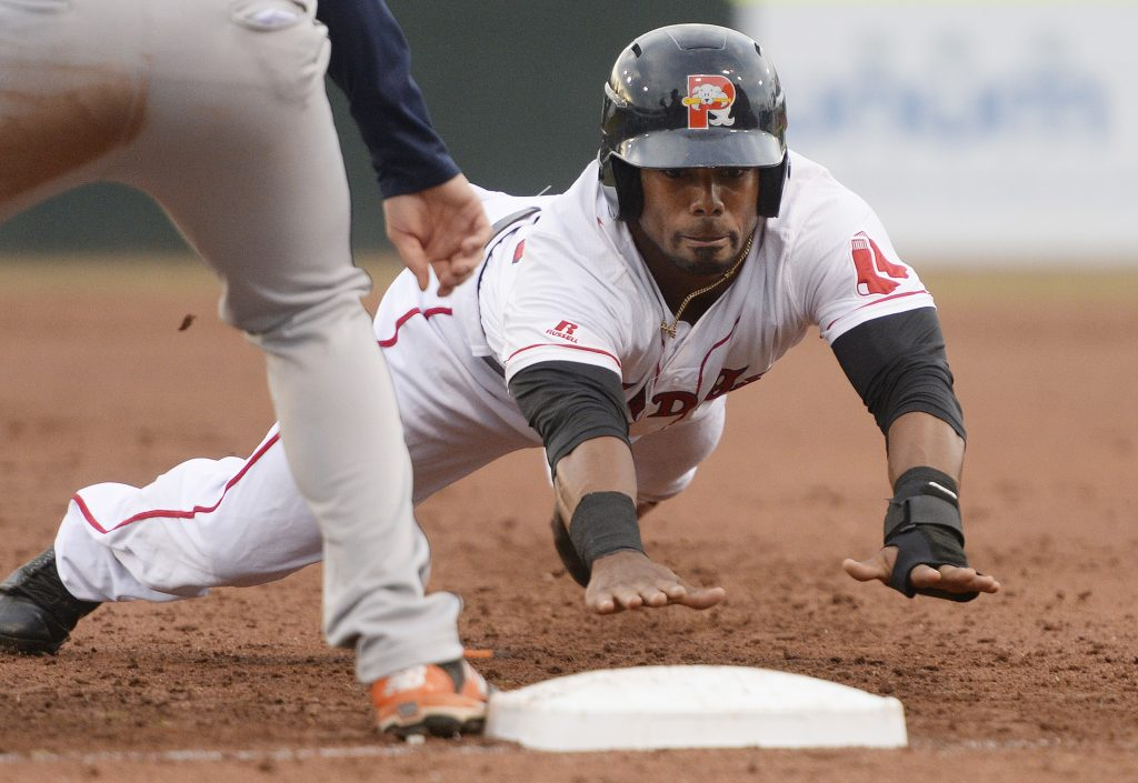 Aneury Tavarez of the Sea Dogs dives back to first base on a pickoff attempt by Binghamton. Tavarez dove in the winning run in the 10th inning with a dribbler between the mound and thirtd base.
