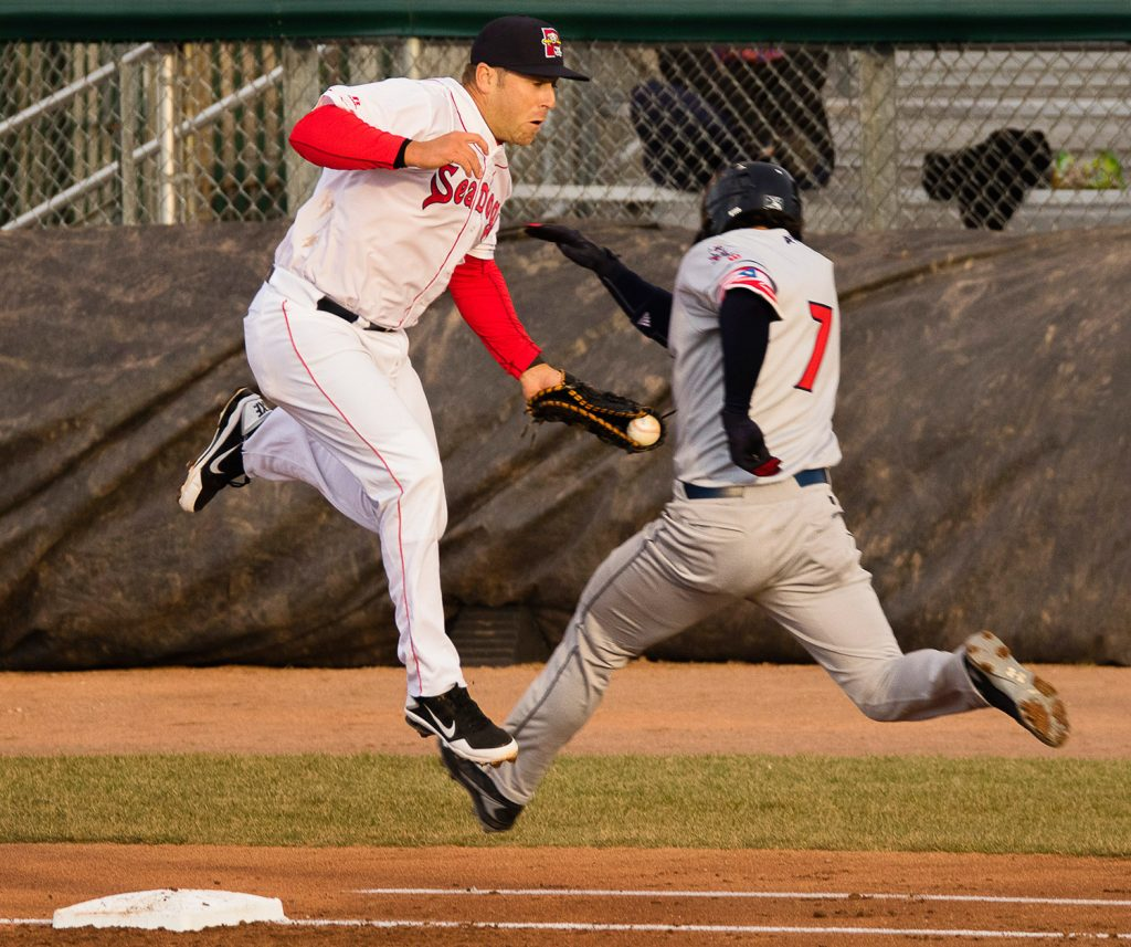 Sea Dogs first baseman Mike Olt handles a bad throw to put out Binghamton's Tomas Nido at first in Monday night's win.