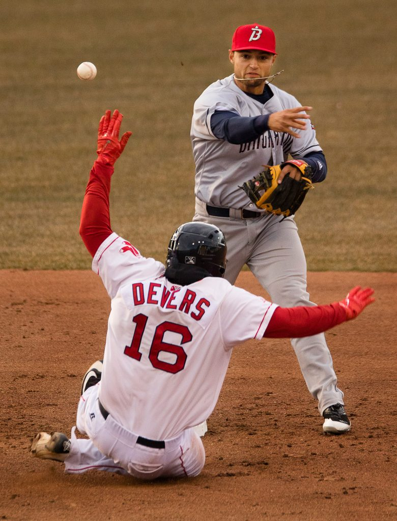 Portland's Rafael Devers slides into second while Binghamton infielder Li Mazzilli tries, but fails, to turn a double play in the second inning.