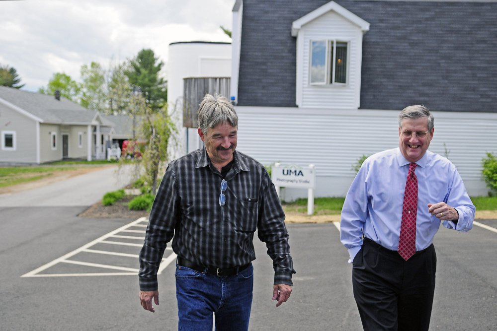 University of Maine at Augusta President James Conneely, on right, who is resigning at the end of the school year, tours buildings on May 19, 2016 at the University of Maine at Augusta. At left is Facility Director Peter St. Michel.
