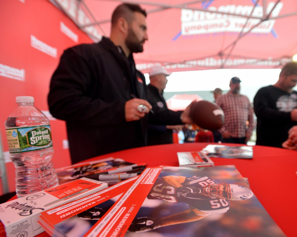 Rob Ninkovich, of the New England Patriots, signs autographs Wednesday at Hammond Lumber Co. in Belgrade during a meet and greet with fans.