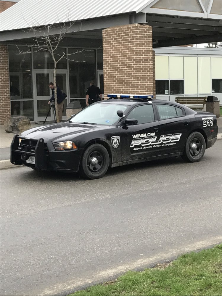 A Winslow Police cruiser is parked outside the high school Friday morning after area schools went into lockout mode as authorities searched for a burglary suspect in the area.