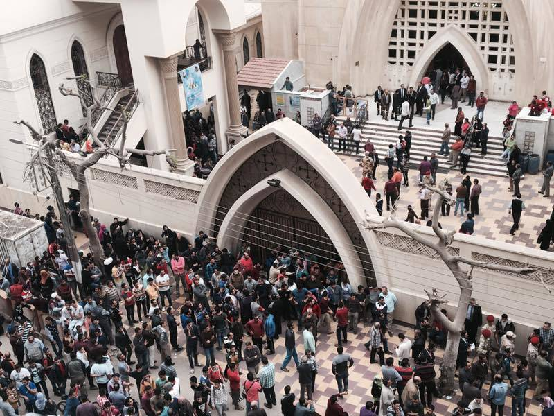 Relatives and onlookers gather outside a church after a bomb attack in the Nile Delta town of Tanta, Egypt, on Sunday. The attack took place on Palm Sunday, the start of the Holy Week leading up to Easter, when the church in the Nile Delta town of Tanta was packed with worshippers.