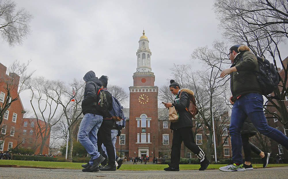 Students walk between classes at Brooklyn College, where current tuition for in-state undergraduates is $6,838 a year.