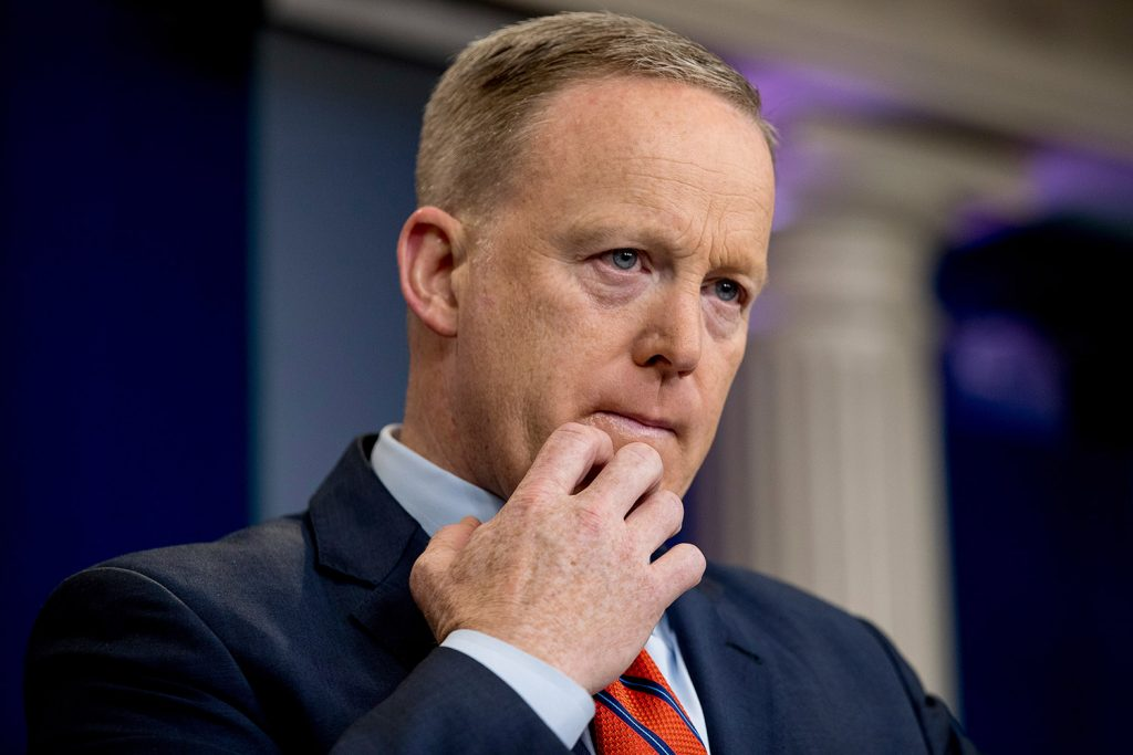 White House press secretary Sean Spicer pauses while talking to the media Tuesday during the daily press briefing at the White House in Washington.