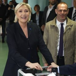 Far-right leader and candidate for the 2017 French presidential election Marine Le Pen casts her vote for the first-round presidential election in Henin-Beaumont, France, on Sunday, April 23, 2017. French voters are casting ballots for their next president in an unusually close first-round election Sunday, after a campaign dominated by concerns about jobs and immigration and clouded by security fears following a recent attack on police guarding the Champs-Elysees in Paris.