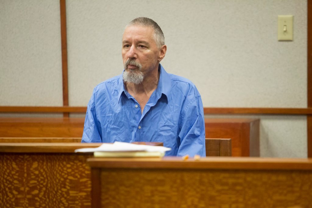 Burton Hagar waits for Judge Thomas Warren to enter the courtroom for his arraignment hearing Wednesday in Portland. Hagar pleaded not guilty to killing his infant son nearly 38 years ago.