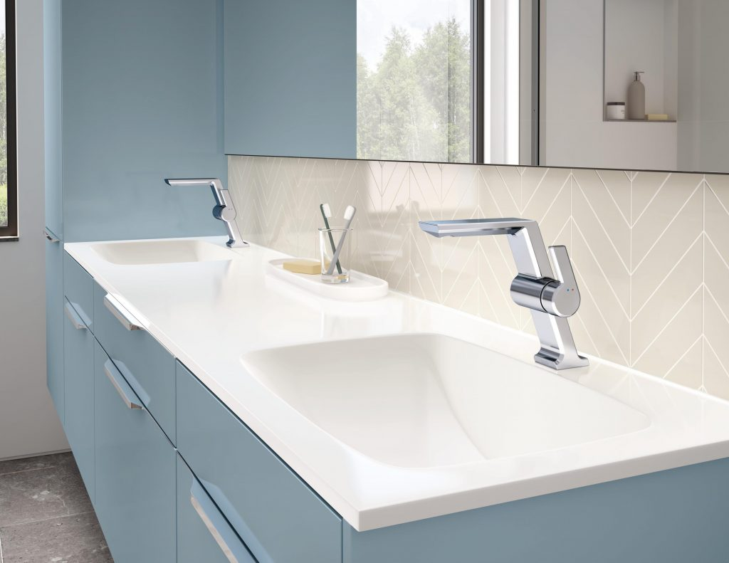 The Pivotal single-handle bath faucet serves as a beautiful centerpiece for the vanity.