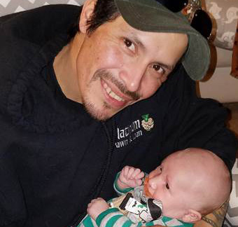 Otto Morales-Caballeros with his grandson.