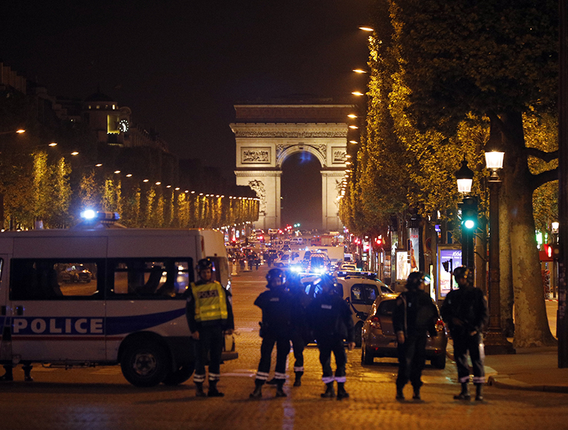 Police seal off the Champs Elysees avenue in Paris after the attack on Thursday.