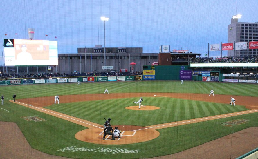 Pitcher Yency Almonte throws the first pitch at Hartford's new Dunkin' Donuts Park on April 13. Issues with the stadium forced the Yard Goats to play on the road all last season.