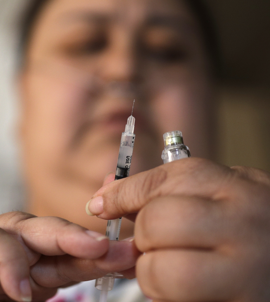 Soila Solano prepares to inject herself with insulin last month at her home in Las Vegas, where a bill to control medical insurance costs is supported by casino owners and their workers.