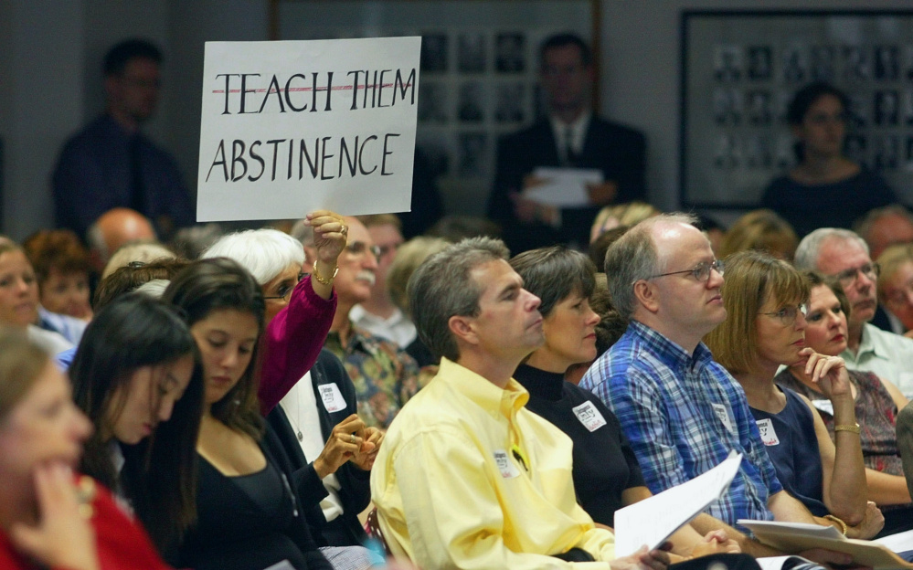 An audience member holds up a sign at a 2004 Texas State Board of Education hearing on proposed new health textbooks. A study released in February showed that 83 percent of school districts in Texas, which has one of the country's highest teen birth rates, offer no sex education or teach only abstinence.