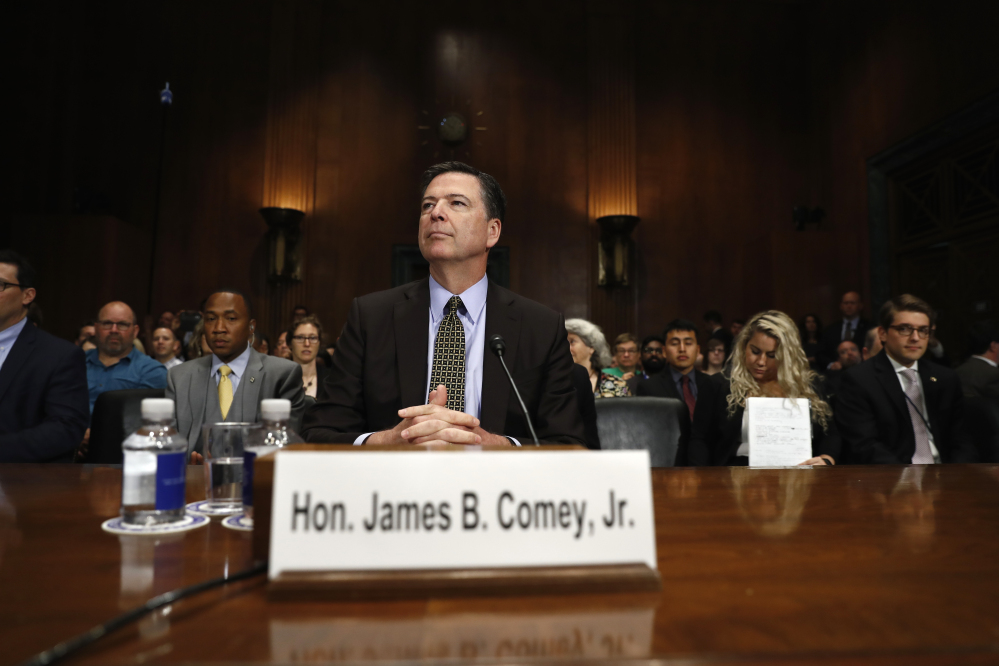 FBI Director James Comey prepares to testify on Capitol Hill in Washington on Wednesday before a Senate Judiciary Committee hearing.