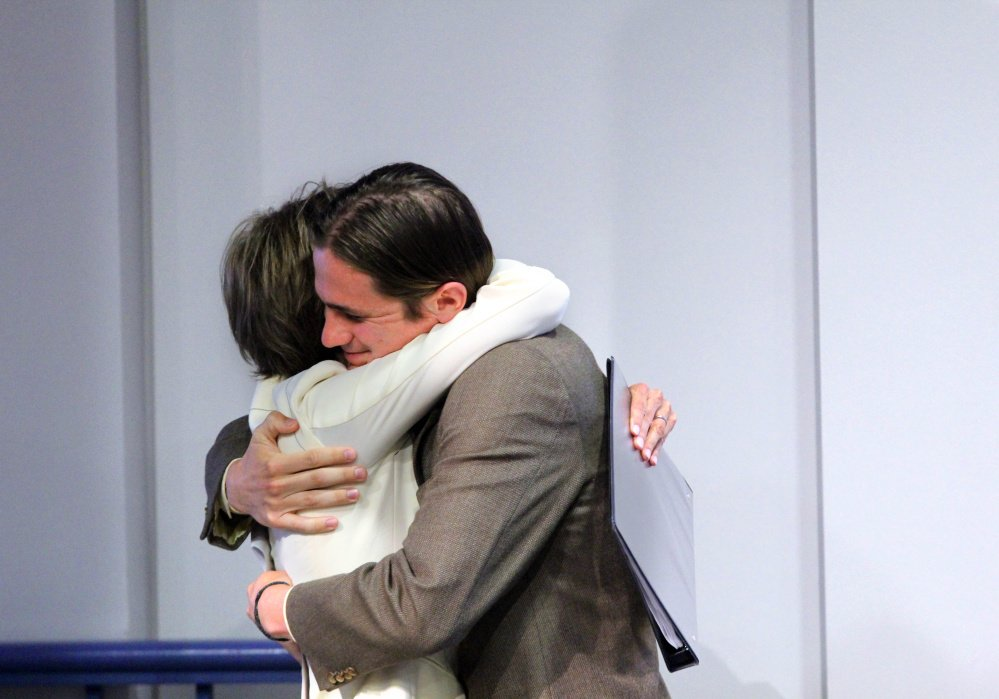 Colby College senior Quill Yates gives his mother — former Acting U.S. Attorney General Sally Yates — a hug after introducing her Wednesday night during her visit to the college campus in Waterville.