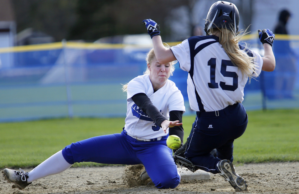 Britney Gregoire of Kennebunk attempts to handle the throw as Ally Gagne of Poland steals second base Wednesday during the fourth inning of Kennebunk's 6-2 victory at home.