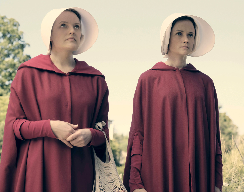 Elisabeth Moss, left, as Offred and Alexis Bledel as Ofglen in the Hulu series
