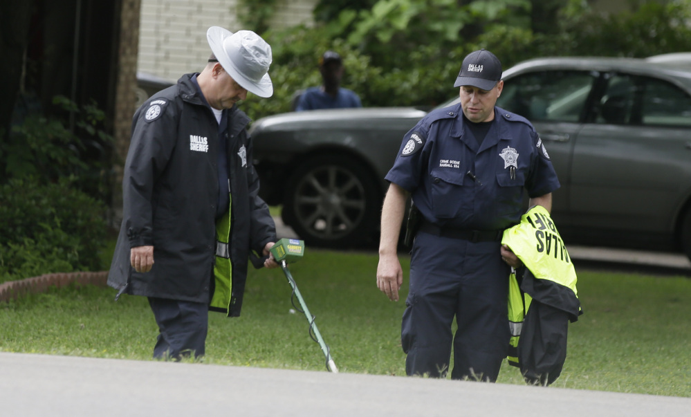 Investigators use a metal detector Wednesday at the intersection in Balch Springs, Texas, near where Jordan Edwards was killed by a police officer on April 29.