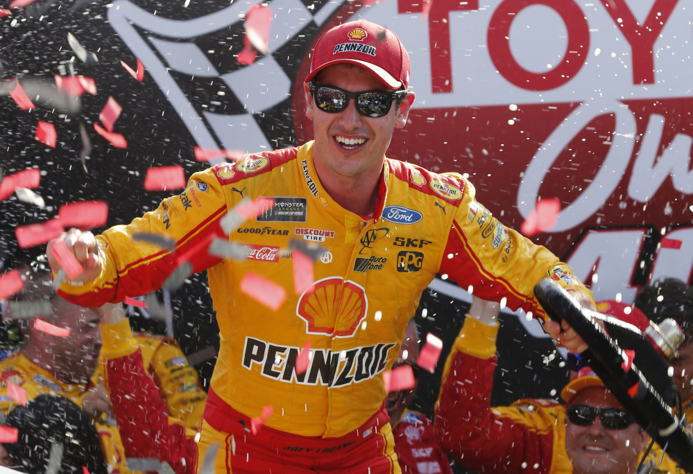 Joey Logano celebrates after his win Sunday at Richmond International Raceway. Logano's car failed the postrace inspection, and NASCAR ruled Thursday that the win won't count toward playoff qualification.