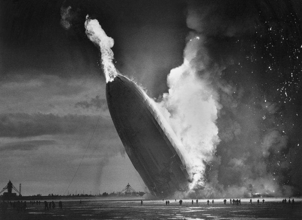 In this May 6, 1937 file photo, the German dirigible Hindenburg crashes to earth in flames after exploding at the U.S. Naval Station in Lakehurst, N.J. Only one person is left of the 62 passengers and crew who survived when the Hindenburg burst into flames 80 years ago Saturday. Werner Doehner was 8 years old when he boarded the zeppelin with his parents and older siblings after their vacation to Germany in 1937. The 88-year-old, now living in Parachute, Colo., told The Associated Press that the airship pitched as it tried to land in New Jersey and that