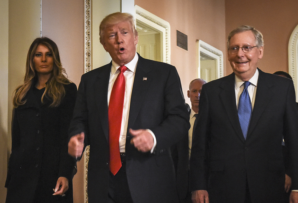 President Trump walks through the U.S. Capitol in Washington with Senate Majority Leader Mitch McConnell, R-Ky. McConnell will lead a health care bill through the Senate.