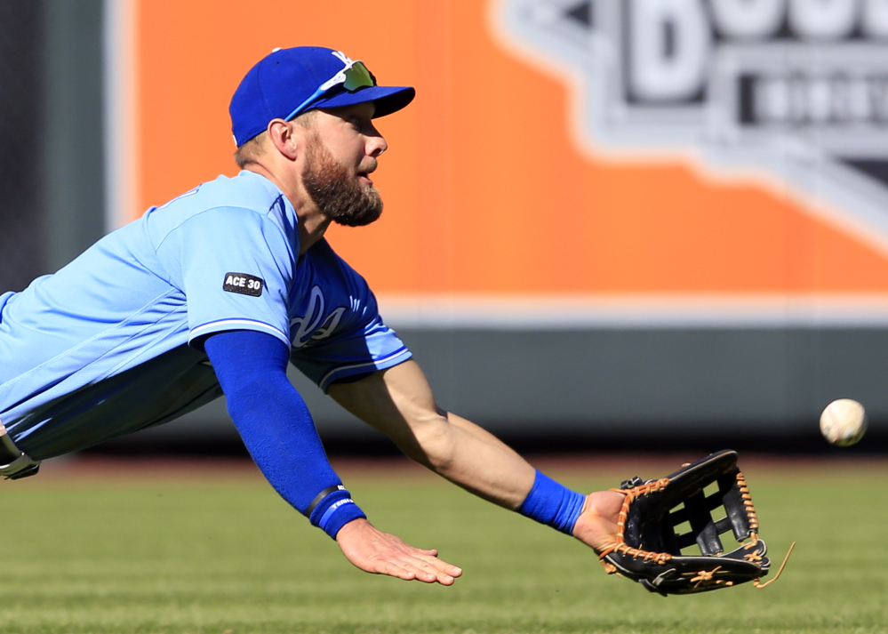 Royals left fielder Alex Gordon catches a fly ball hit by the Indians' Abraham Almonte during the seventh inning of their game Saturday in Kansas City, Mo. Cleveland won 3-1.