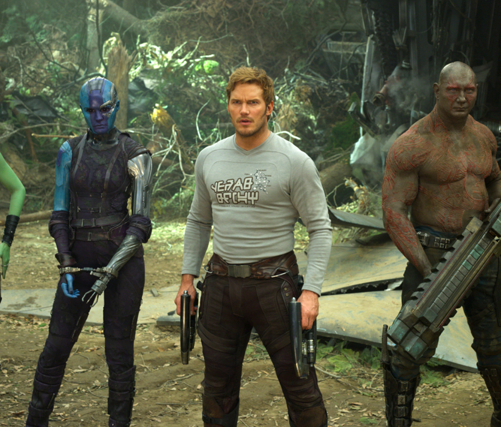From left, Karen Gillan, Chris Pratt and Dave Bautista appear in a scene from