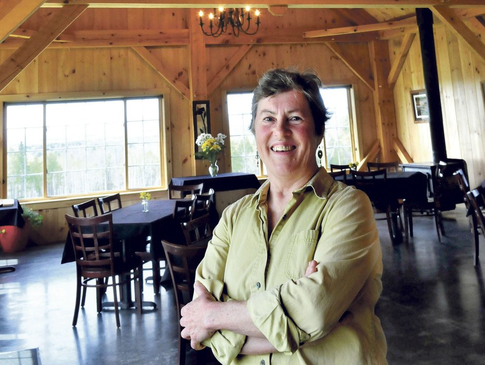 Mary Burr stands inside 122 Corson, her timber-framed restaurant in Mercer, which features locally grown and raised vegetables and meats and fancy desserts.