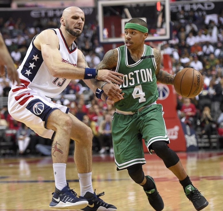 Boston Celtics guard Isaiah Thomas dribbles against Wizards center Marcin Gortat during the second half in Game 4 on  Sunday in Washington.