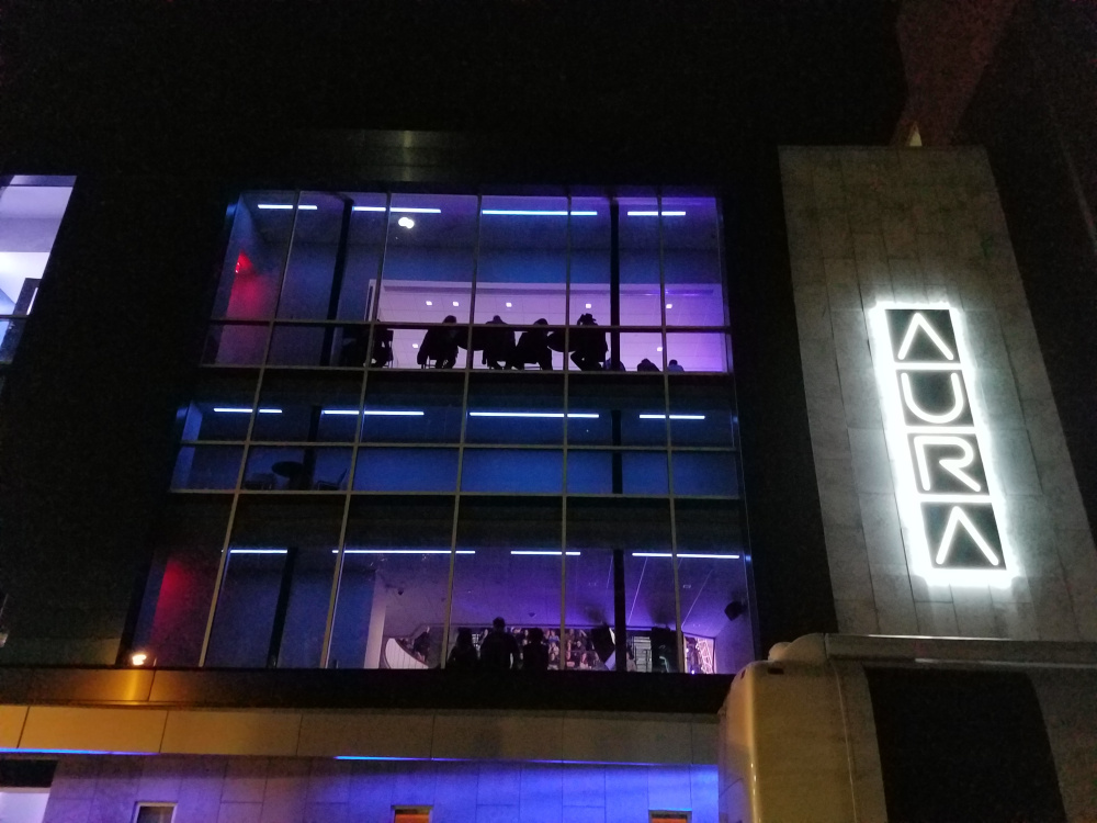 The new Aura's lit facade on the night of Dwight Yoakam's performance.